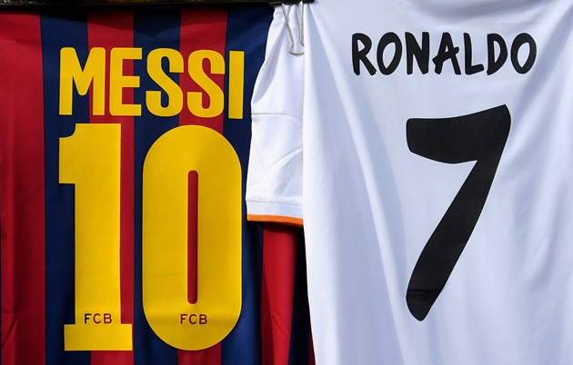 MADRID, SPAIN - MARCH 23:  Shirts bearing the names of Lionel Messi of FC Barcelona and Cristiano Ronaldo of Real Madrid CF are seen on display at a merchandise stall prior to the La Liga match between Real Madrid CF and FC Barcelona at estadio Santiago Bernabeu on March 23, 2014 in Madrid, Spain.  (Photo by Denis Doyle/Getty Images)