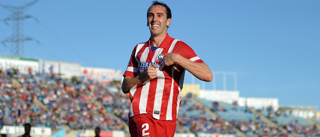 GETAFE, SPAIN - APRIL 13:  Diego Godin of Club Atletico de Madrid celebrates after scoring his team's opening goal during the La  Liga match between Getafe CF and Club Atletico de Madrid at Coliseum Alfonso Perez stadium on April 13, 2014 in Getafe, Spain.  (Photo by Denis Doyle/Getty Images)