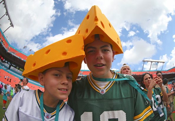 MIAMI GARDENS, FL - OCTOBER 12:  Green Bay Packers fans wear cheese headgear before the Miami Dolphins met the Green Bay Packers in their NFL game at Sun Life Stadium on October 12, 2014 in Miami Gardens, Florida.  (Photo by Mike Ehrmann/Getty Images)