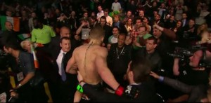Conor McGregor jumps Octagon
