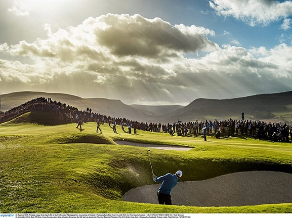 23 January 2015; Winning image from Sportsfile at the Professional Photographers Association of Ireland - Photographer of the Year Awards 2015. 1st Prize Sports Feature - LIGHTING UP THE FAIRWAY - Matt Browne. 26 September 2014; Rory McIlroy, Team Europe, plays from a bunker back onto the 8th fairway during the Morning Fourball Matches. The 2014 Ryder Cup, Day 1. Gleneagles, Scotland. Picture credit: Matt Browne / SPORTSFILE