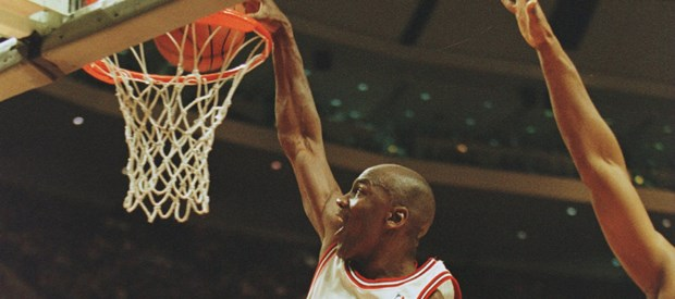 27 Feb 1996:  Shooting guard Michael Jordan of the Chicago Bulls focuses on the rim as he is caught in mid air attempting a slam dunk during the Bull's 120-99 victory over the Minnesota Timberwolves at the United Center in Chicago, Illinois.   Mandatory Credit: Brian Bahr/ALLSPORT