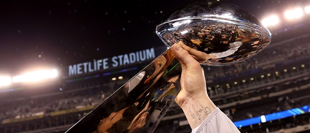 EAST RUTHERFORD, NJ - FEBRUARY 02:  A Seattle Seahawk holds up the Vince Lombardi Trophy after their 43-8 win over the Denver Broncos during Super Bowl XLVIII at MetLife Stadium on February 2, 2014 in East Rutherford, New Jersey.  (Photo by Jeff Gross/Getty Images)