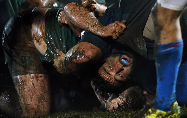 The two teams scrum in muddy conditions 6/2/2015