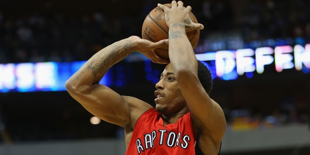 DALLAS, TX - FEBRUARY 24:  DeMar DeRozan #10 of the Toronto Raptors takes a shot against the Dallas Mavericks at American Airlines Center on February 24, 2015 in Dallas, Texas.  NOTE TO USER: User expressly acknowledges and agrees that, by downloading and or using this photograph, User is consenting to the terms and conditions of the Getty Images License Agreement.  (Photo by Ronald Martinez/Getty Images)