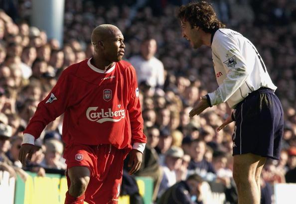 El Hadji Diouf of Liverpool argues with Mauricio Taricco of Tottenham Hotspur