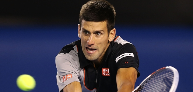 MELBOURNE, AUSTRALIA - JANUARY 21:  Novak Djokovic of Serbia plays a backhand in his quarterfinal match against Stanislas Wawrinka of Switzerland during the 2014 Australian Open at Melbourne Park on January 21, 2014 in Melbourne, Australia.  (Photo by Michael Dodge/Getty Images)