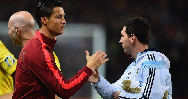 MANCHESTER, ENGLAND - NOVEMBER 18:  Cristiano Ronaldo of Portugal shakes hands with Lionel Messi of Argentina prior to the International Friendly between Argentina and Portugal at Old Trafford on November 18, 2014 in Manchester, England.  (Photo by Laurence Griffiths/Getty Images)