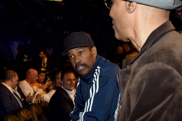 """LAS VEGAS, NV - MAY 02:  Actor Denzel Washington sits ringside At """"Mayweather VS Pacquiao"""" presented by SHOWTIME PPV And HBO PPV at MGM Grand Garden Arena on May 2, 2015 in Las Vegas, Nevada.  (Photo by Ethan Miller/Getty Images for SHOWTIME)"""