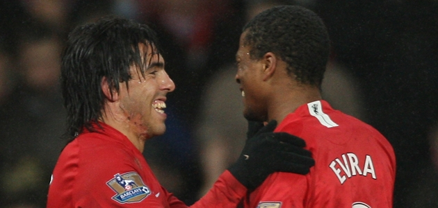 MANCHESTER, UNITED KINGDOM - DECEMBER 08:  Carlos Tevez of Manchester United is congratulated by team mate Patrice Evra (R) after scoring the second goal during the Barclays Premier League match between Manchester United and Derby County at Old Trafford on December 8, 2007 in Manchester, England.  (Photo by Alex Livesey/Getty Images)