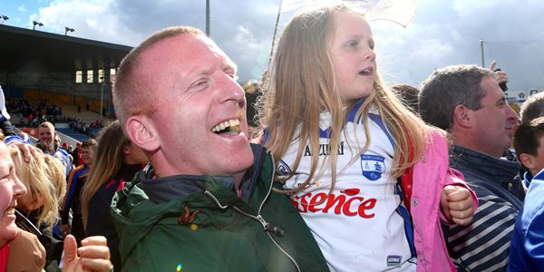 Allianz Hurling League Division 1 Final, Semple Stadium, Co. Tipperary 3/5/2015 Waterford vs Cork John Mullane and his daughter Abby celebrate with Waterford supporters on the pitch after the game Mandatory Credit ©INPHO/Cathal Noonan