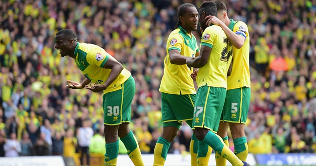 NORWICH, ENGLAND - MAY 16:  Cameron Jerome of Norwich City (2L) celebrates with team mates as he scores their third goal during the Sky Bet Championship Playoff semi final second leg match between Norwich City and Ipswich Town  at Carrow Road on May 16, 2015 in Norwich, England.  (Photo by Jamie McDonald/Getty Images)