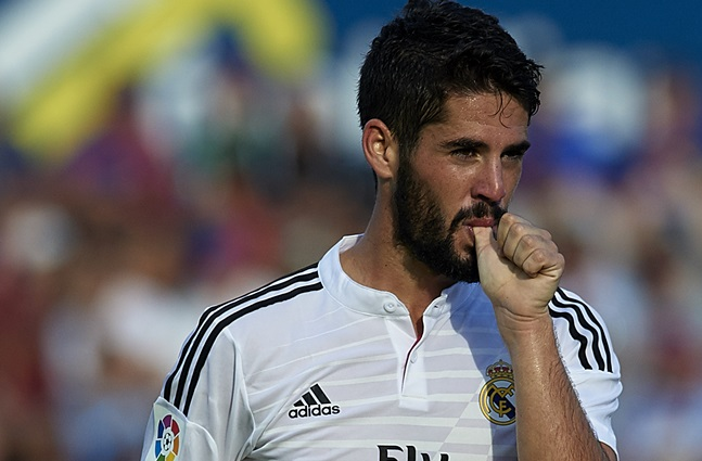 VALENCIA, SPAIN - OCTOBER 18:  Isco of Real Madrid celebrates after scoring during the La Liga match between Levante UD and Real Madrid at Ciutat de Valencia on October 18, 2014 in Valencia, Spain.  (Photo by Manuel Queimadelos Alonso/Getty Images)