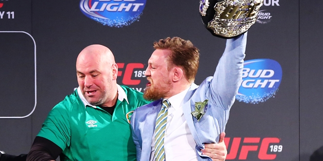 UFC 189 World Championship Tour, The Convention Centre Dublin 31/3/2015 Conor McGregor takes Jose Aldo's belt as UFC's Dana White attempts to intervene Mandatory Credit ©INPHO/Cathal Noonan