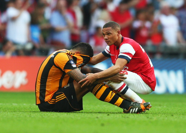 LONDON, ENGLAND - MAY 17:  Kieran Gibbs of Arsenal consoles Jake Livermore of Hull City after the FA Cup with Budweiser Final match between Arsenal and Hull City at Wembley Stadium on May 17, 2014 in London, England.  (Photo by Paul Gilham/Getty Images)