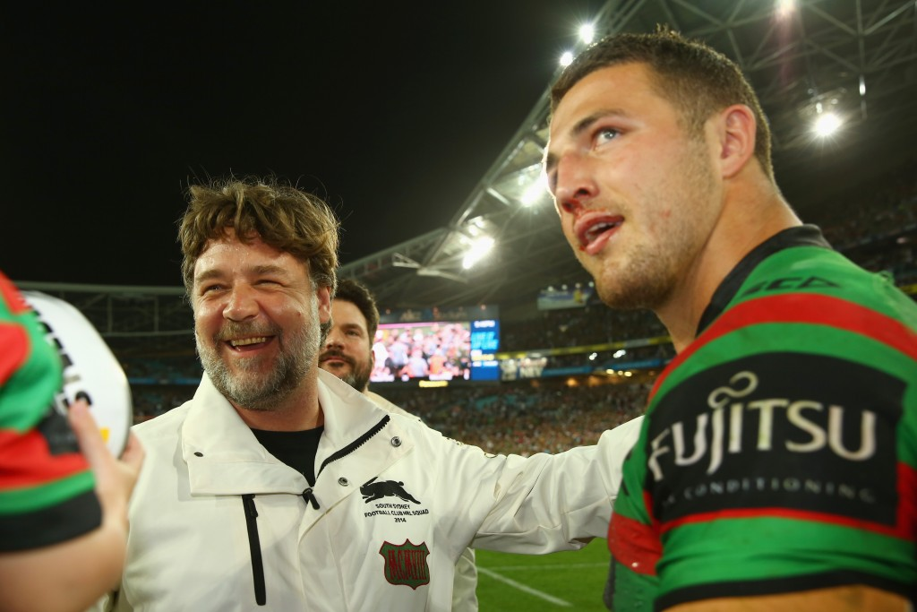 SYDNEY, AUSTRALIA - OCTOBER 05: Rabbitohs coach Russell Crowe speaks to Sam Burgess of the Rabbitohs after victory during the 2014 NRL Grand Final match between the South Sydney Rabbitohs and the Canterbury Bulldogs at ANZ Stadium on October 5, 2014 in Sydney, Australia. (Photo by Mark Kolbe/Getty Images)