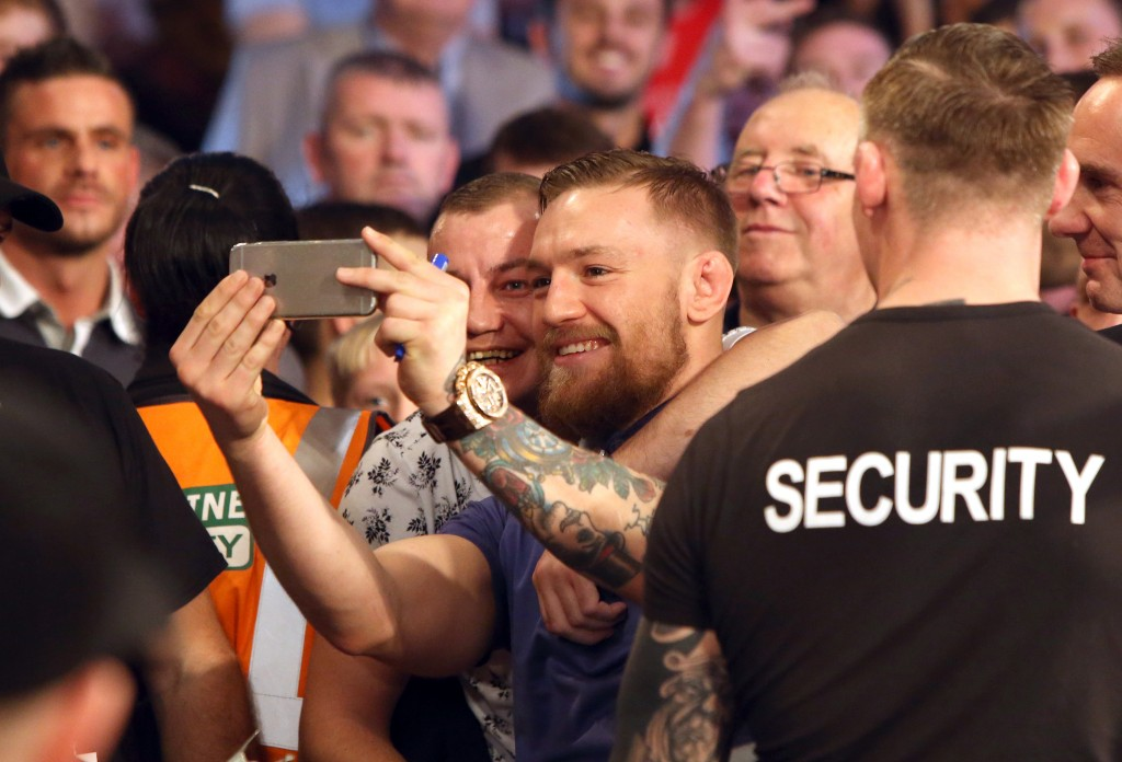 Conor McGregor poses with fans at the event 7/11/2015