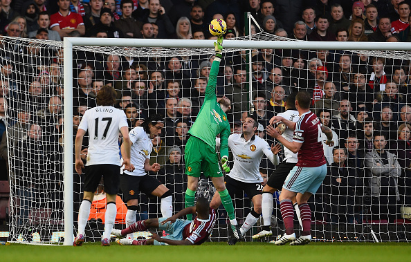 LONDON, ENGLAND - FEBRUARY 08: David De Gea of Manchester United makes a save from Enner Valencia of West Ham during the Barclays Premier League match between West Ham United and Manchester United at Boleyn Ground on February 8, 2015 in London, England. (Photo by Mike Hewitt/Getty Images)