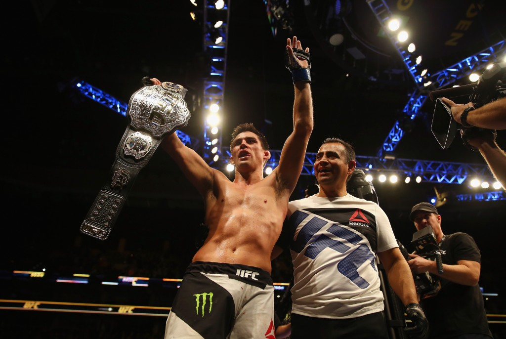 BOSTON, MA - JANUARY 17:  Dominick Cruz celebrates defeating T.J. Dillashaw (not pictured) to win the World Bantamweight Championship during UFC Fight Night 81 at TD Banknorth Garden on January 17, 2016 in Boston, Massachusetts.  (Photo by Maddie Meyer/Getty Images)