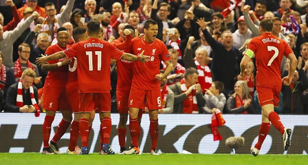 LIVERPOOL, UNITED KINGDOM - MAY 05: Dejan Lovren (6) celebrates with team mates and fans as Adam Lallana of Liverpool (obscured) scores their third goal during the UEFA Europa League semi final second leg match between Liverpool and Villarreal CF at Anfield on May 5, 2016 in Liverpool, England. (Photo by Richard Heathcote/Getty Images)