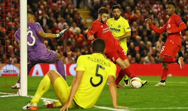 LIVERPOOL, UNITED KINGDOM - MAY 05: Adam Lallana of Liverpool (C) scores their third goal past goalkeeper Alphonse Areola of Villarreal during the UEFA Europa League semi final second leg match between Liverpool and Villarreal CF at Anfield on May 5, 2016 in Liverpool, England. (Photo by Richard Heathcote/Getty Images)
