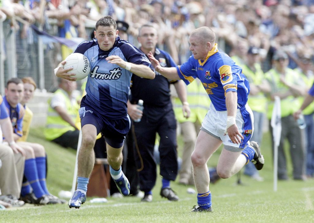 Leinster Football Championship 4/6/2006 Longford vs Dublin Alan Brogan of Dublin with Dermot Brady of Longford Mandatory Credit ©INPHO/Donall Farmer