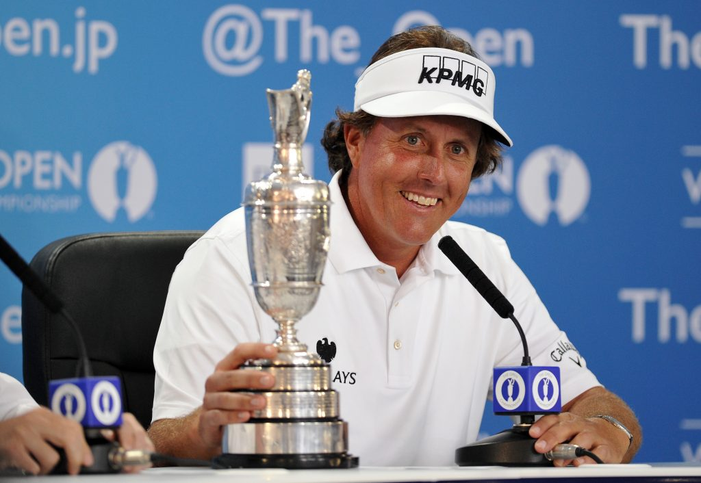 GULLANE, SCOTLAND - JULY 21: Phil Mickelson of the United States holds the Claret Jug as he answers questions after winning the 142nd Open Championship at Muirfield on July 21, 2013 in Gullane, Scotland. (Photo by Stuart Franklin/Getty Images)