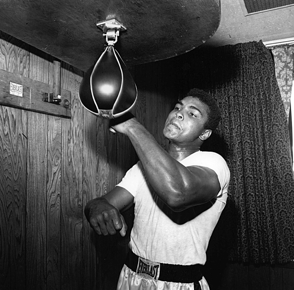 Muhammad Ali (Cassius Clay) on the punch ball at his training camp in preparation for a defence of his Heavyweight crown. 1965 ©INPHO/ALLSPORT