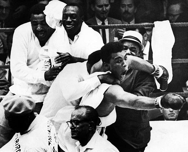 "27/2/1964 World Heavyweight Title Cassius Clay (Muhammad Ali) flies around the ring, it was during these scenes that Clay claimed, ""I am the Greatest"" and ""I shook up the World"". ©INPHO/Allsport"