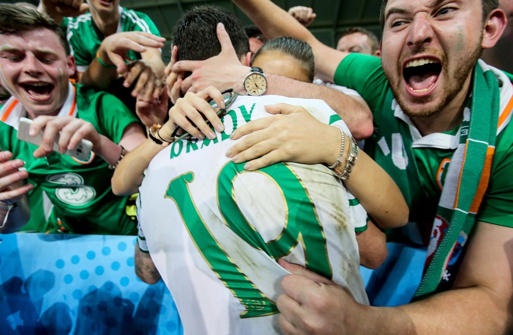 Robbie Brady celebrates with his girlfriend Kerrie Harris and supporters after the game 22/6/2016