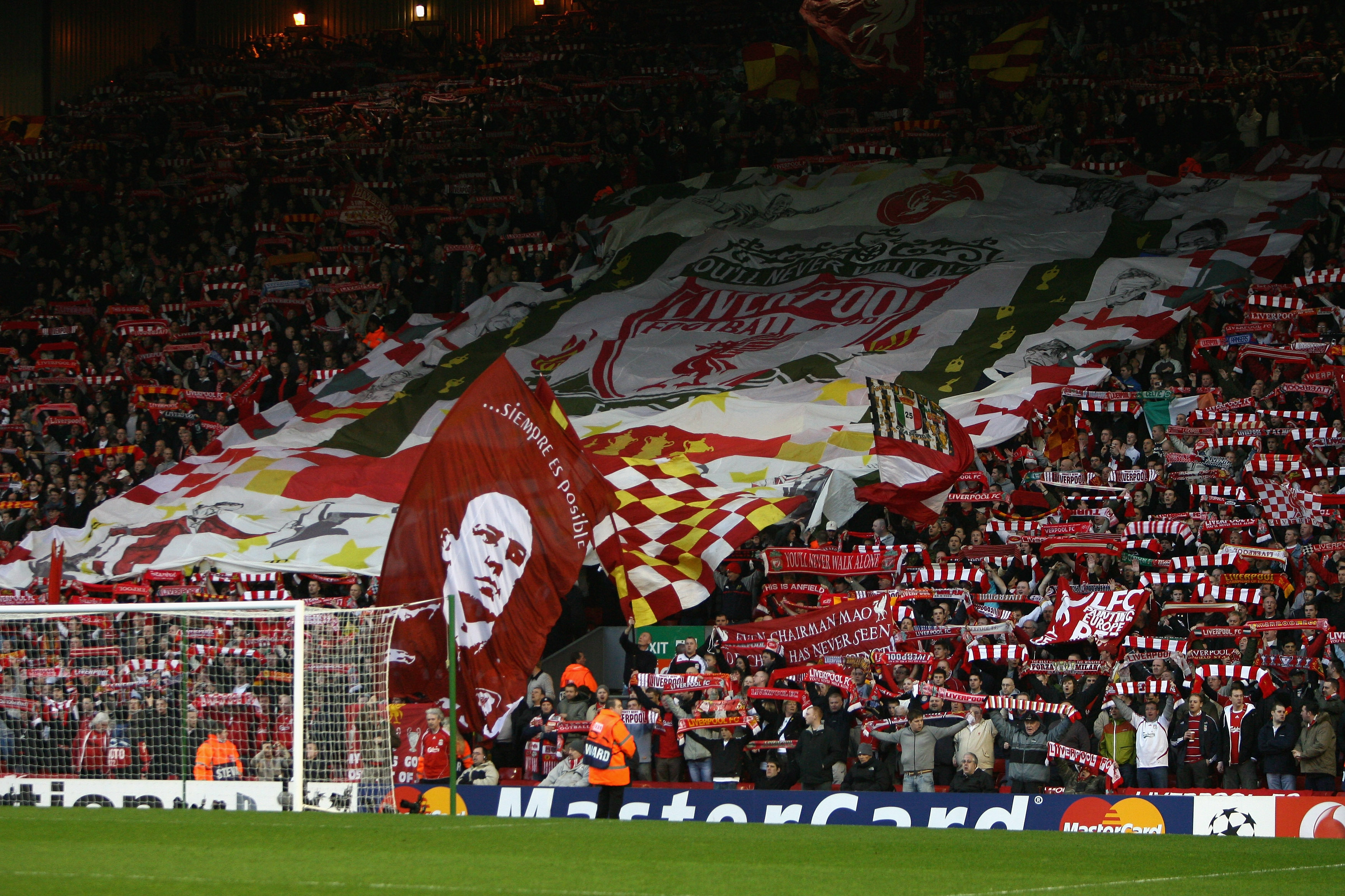 LIVERPOOL, UNITED KINGDOM - APRIL 08: Supporters on the Kop show off their flags and scarves prior to the UEFA Champions League Quarter Final, second leg match between Liverpool and Arsenal at Anfield on April 8, 2008 in Liverpool, England. (Photo by Clive Brunskill/Getty Images)