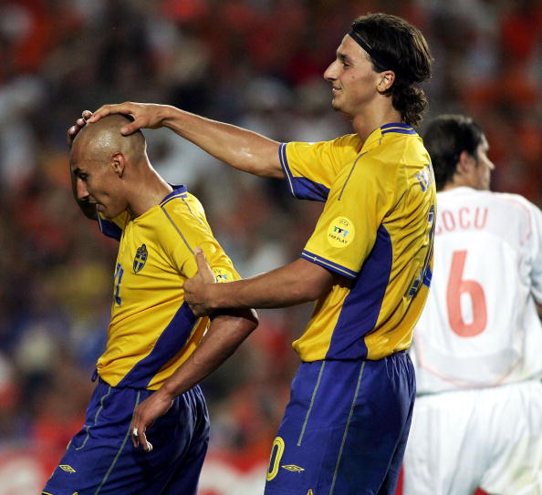 FARO, PORTUGAL - JUNE 26:  Henrik Larsson of Sweden is consoled by Zlatan Ibrahimovic after his shot hits the bar during the UEFA Euro 2004, Quarter Final match between Sweden and Holland at the Algarve Stadium on June 26, 2004 in Faro, Portugal.  (Photo by Ben Radford/Getty Images)