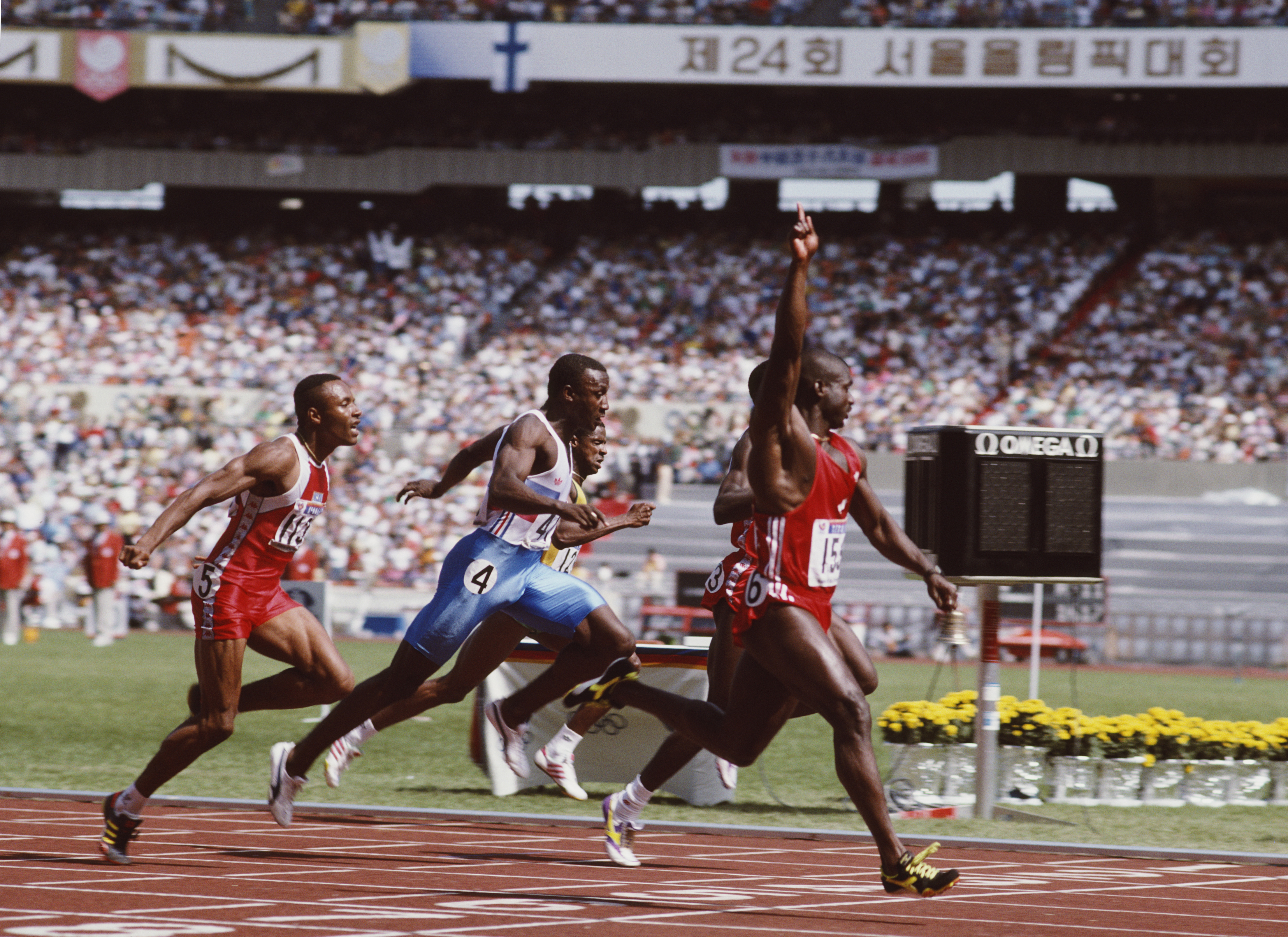 Ben Johnson of Canada celebrates winning gold in the Men's 100 metres final on 24 September 1988 during the XXIV Olympic Games at the Seoul Olympic Stadium in Seoul, South Korea. Ben Johnson was later disqualified for the illegal use of performance enhancing drugs.(Photo by David Cannon/Getty Images)
