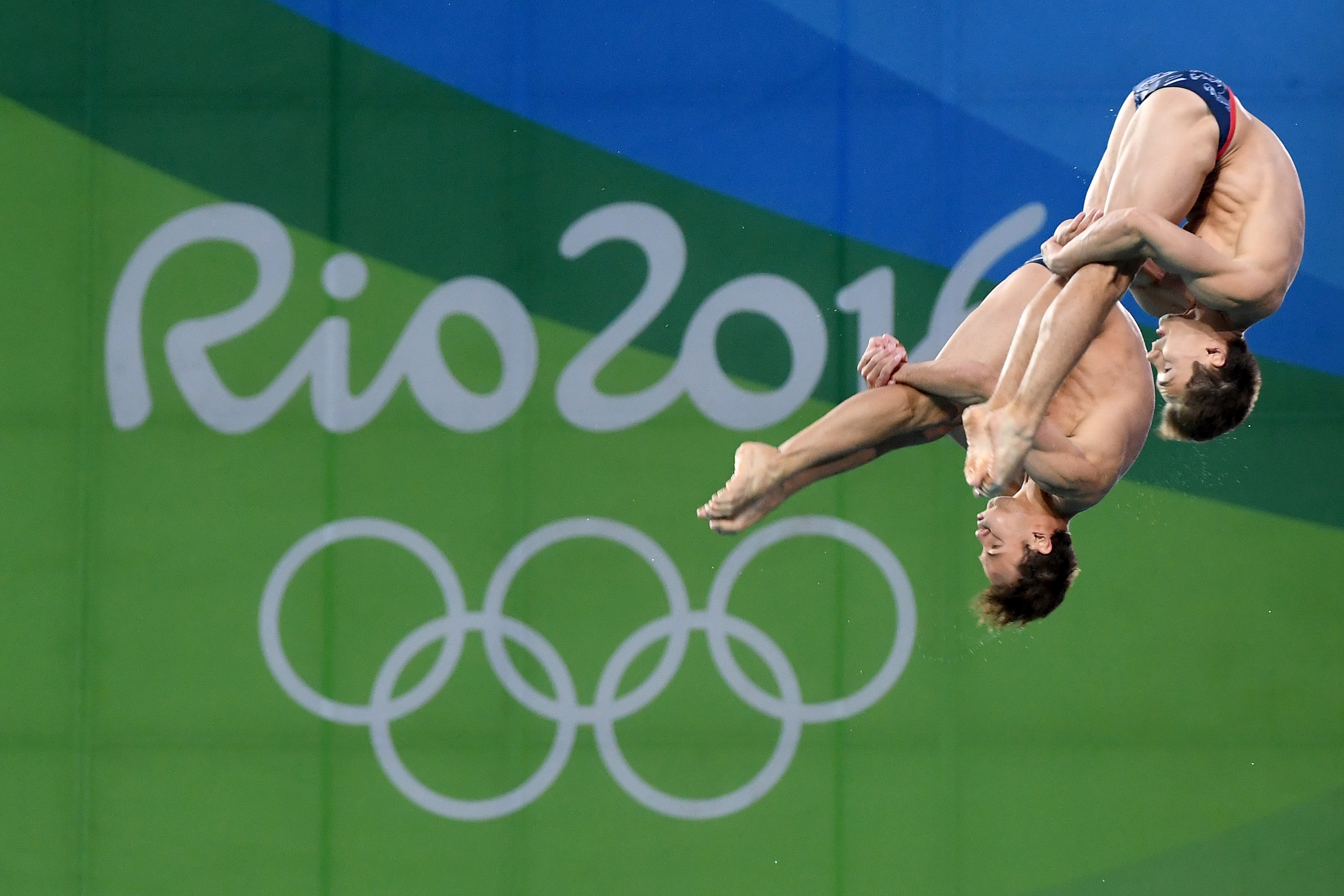 RIO DE JANEIRO, BRAZIL - AUGUST 08: Tom Daley and Daniel Goodfellow of Great Britain compete in the Men's Diving Synchronised 10m Platform Final on Day 3 of the Rio 2016 Olympic Games at Maria Lenk Aquatics Centre on August 8, 2016 in Rio de Janeiro, Brazil. (Photo by Quinn Rooney/Getty Images)