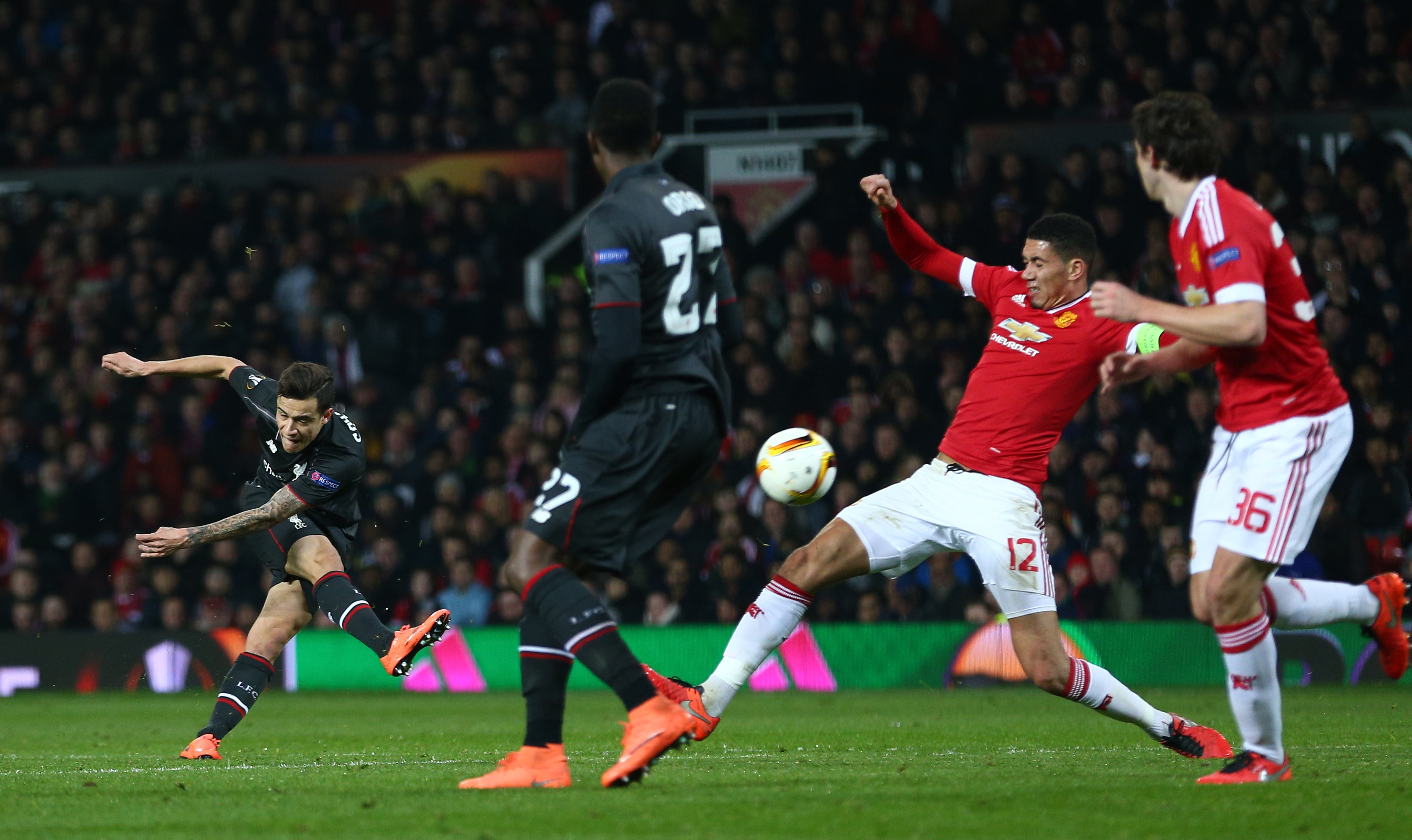 MANCHESTER, ENGLAND - MARCH 17: Philippe Coutinho of Liverpool shoots at goal during the UEFA Europa League round of 16, second leg match between Manchester United and Liverpool at Old Trafford on March 17, 2016 in Manchester, England. (Photo by Clive Brunskill/Getty Images)