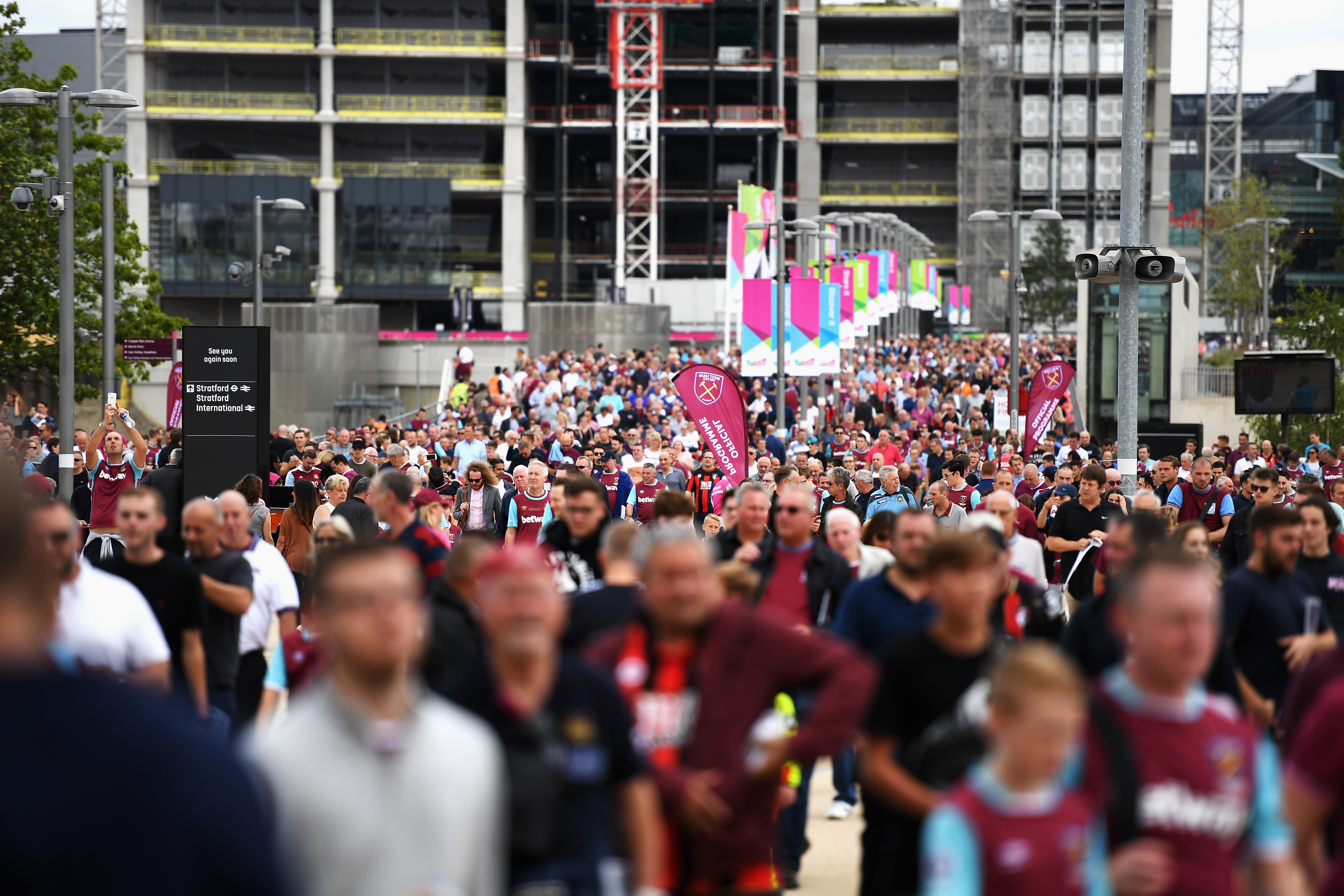 LONDON, ENGLAND - AUGUST 21: Fans walk towards the stadium prior to the Premier League match between West Ham United and AFC Bournemouth at London Stadium on August 21, 2016 in London, England. (Photo by Mike Hewitt/Getty Images)