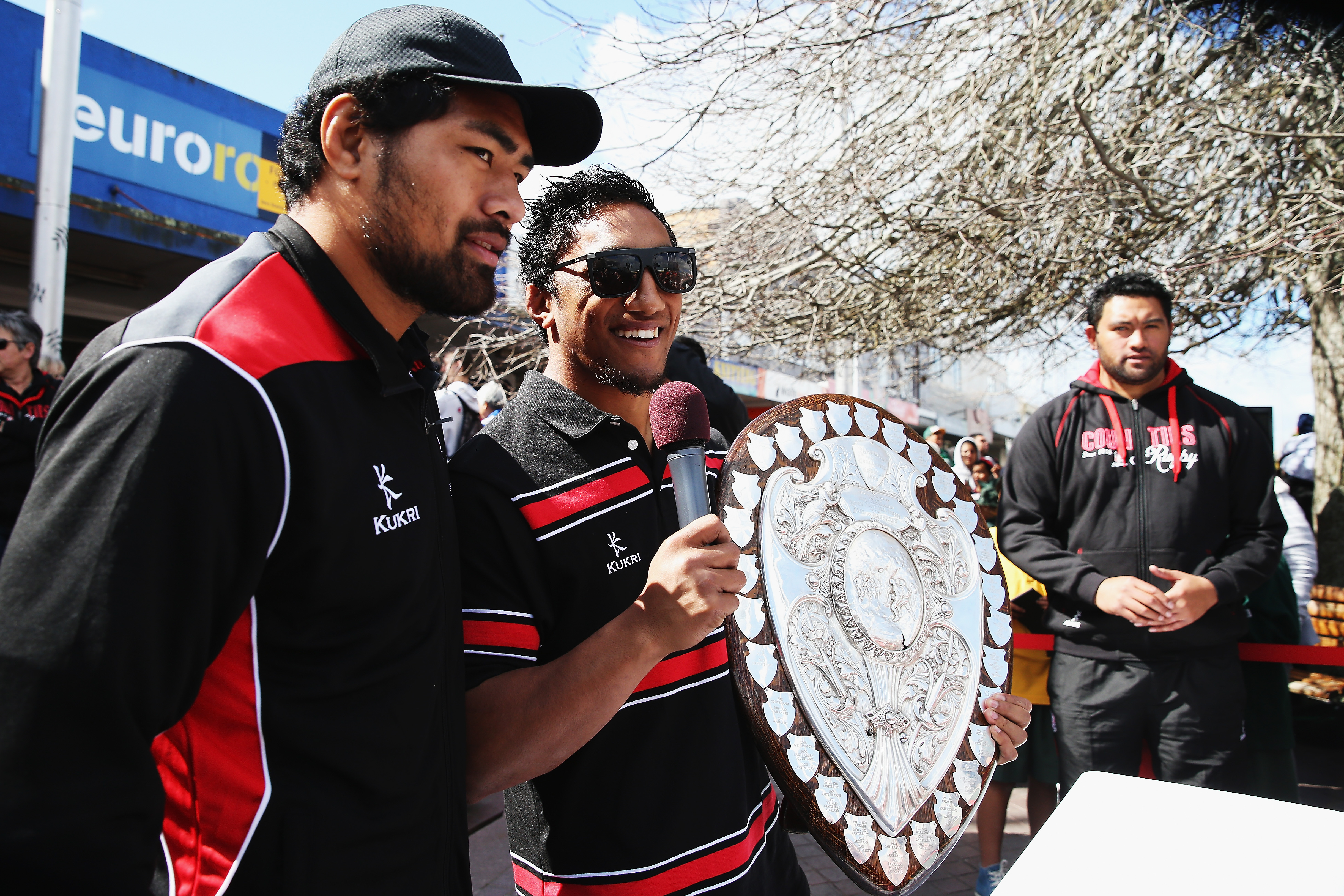 PAPAKURA, NEW ZEALAND - SEPTEMBER 09: Bundee Aki and Fritz Lee of Counties Manukau pose for photos during a victory parade with the Ranfurly Shield on September 9, 2013 in Papakura, New Zealand. Counties Manukau defeated Hawke's Bay on Saturday in the ITM Cup match to hold the Ranfurly Shield. (Photo by Hannah Peters/Getty Images)
