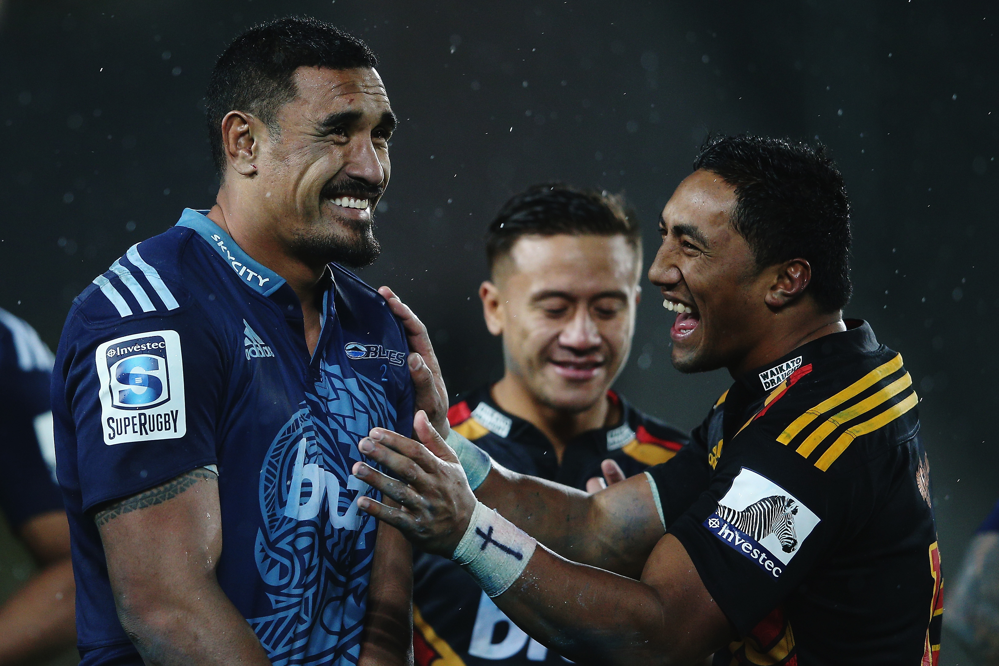 AUCKLAND, NEW ZEALAND - JULY 11: Jerome Kaino of the Blues and Bundee Aki of the Chiefs share a joke following the round 19 Super Rugby match between the Blues and the Chiefs at Eden Park on July 11, 2014 in Auckland, New Zealand. (Photo by Hannah Peters/Getty Images)