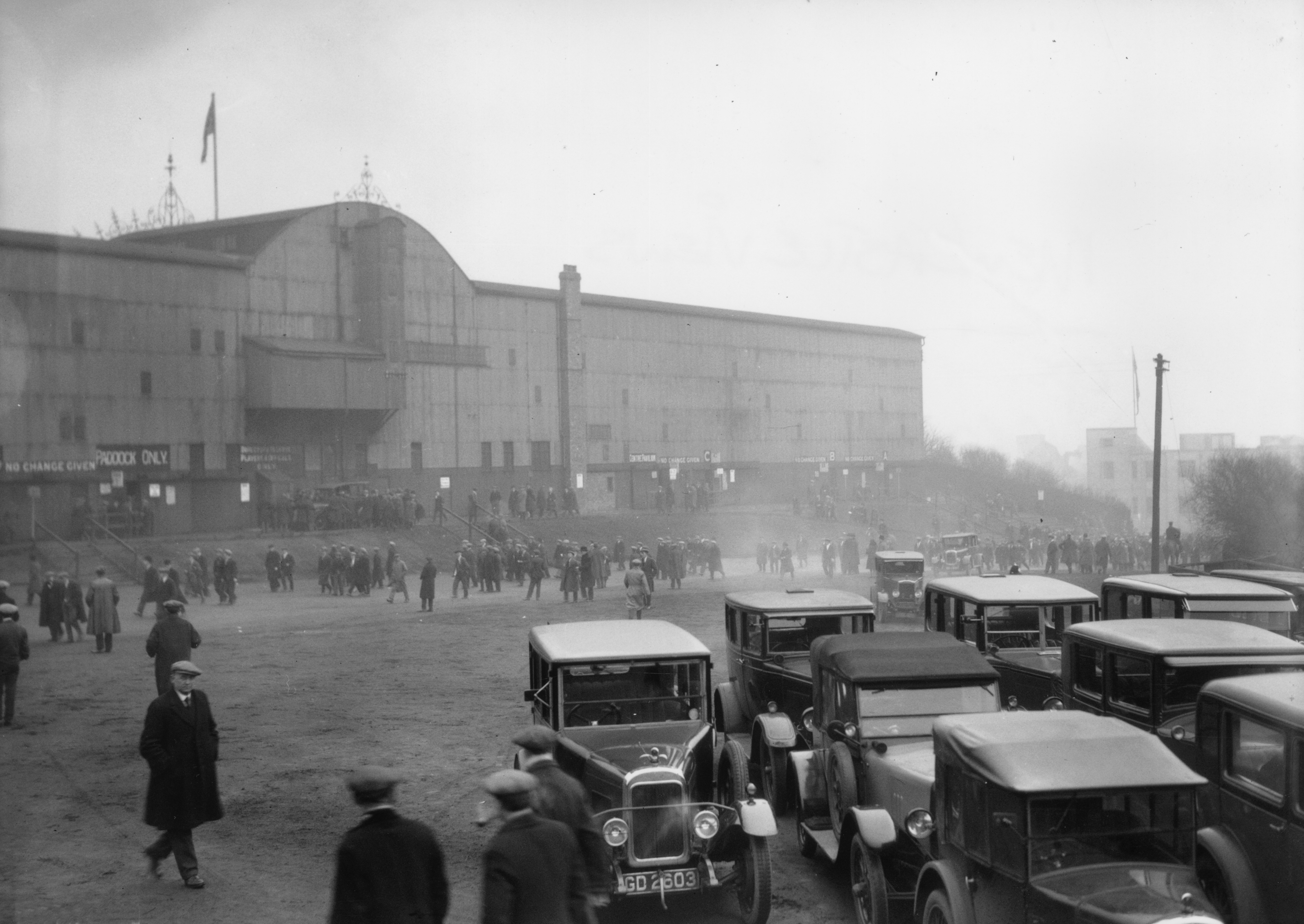 March 1930: Cars parked outside and pedestrians approaching St James Park, home of Newcastle football club. (Photo by Fox Photos/Getty Images)