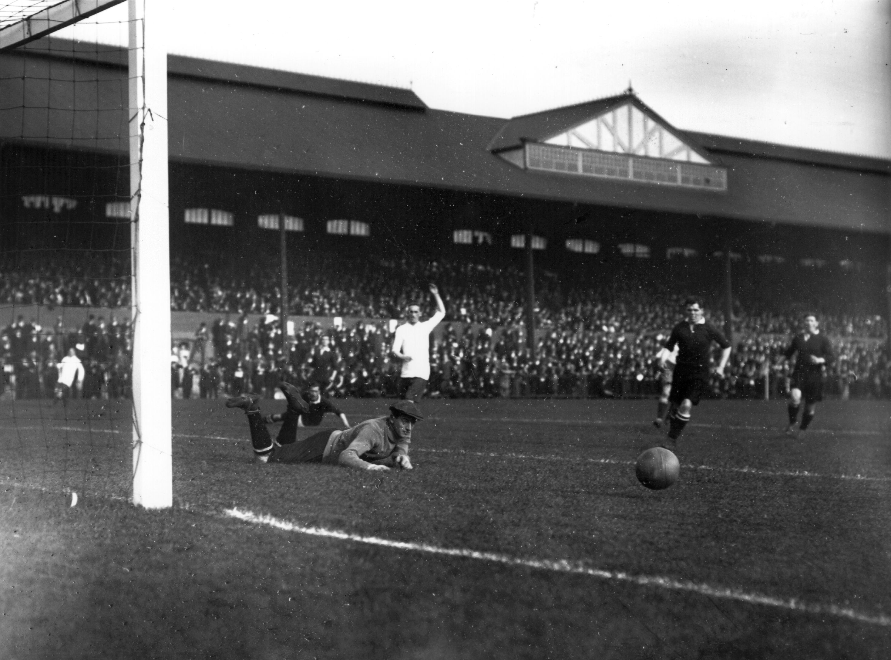 21st September 1912: Fulham's goalkeeper pushes the ball from the goalmouth during their match against Bury at Craven Cottage. (Photo by Topical Press Agency/Getty Images)