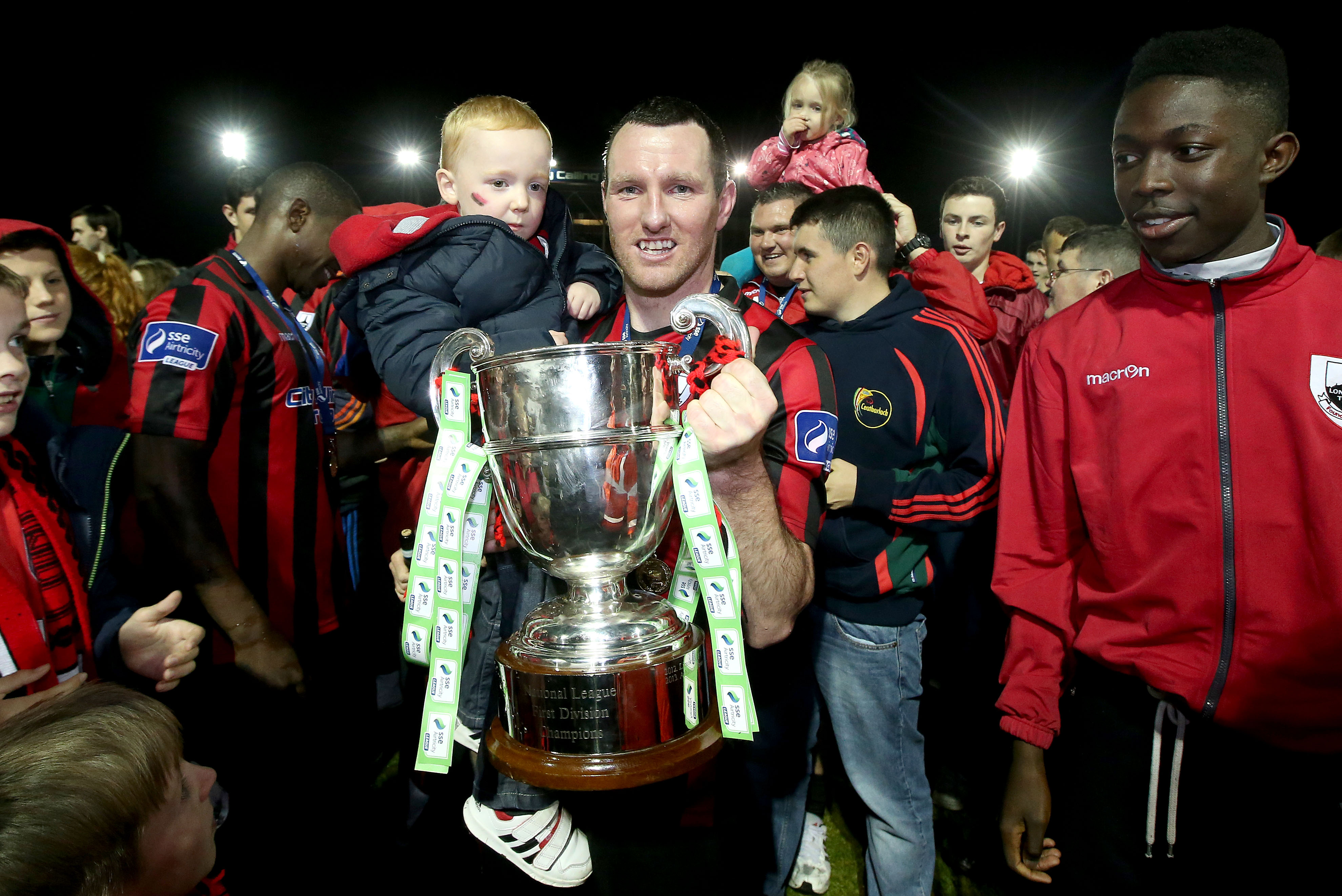 Pat Flynn and his son Senan celebrate with The First Division Trophy 3/10/2014