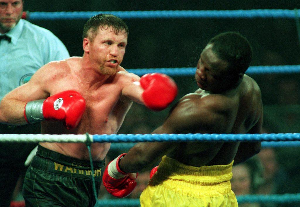 Steve Collins lands a punch on Chris Eubank 1995 ©INPHO/Billy Stickland