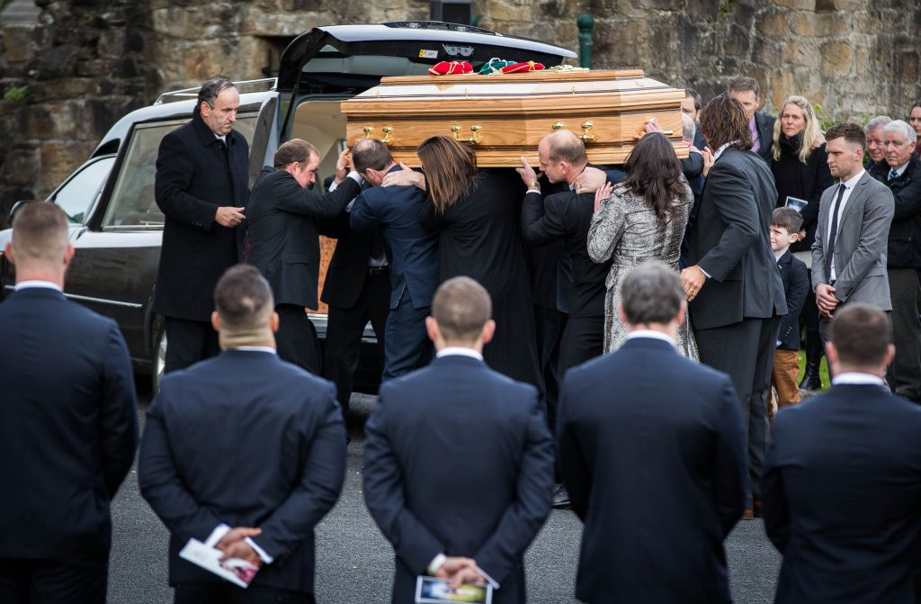 The coffin of Munster Rugby head coach Anthony Foley arrives at St. Flannan's Church 21/10/2016