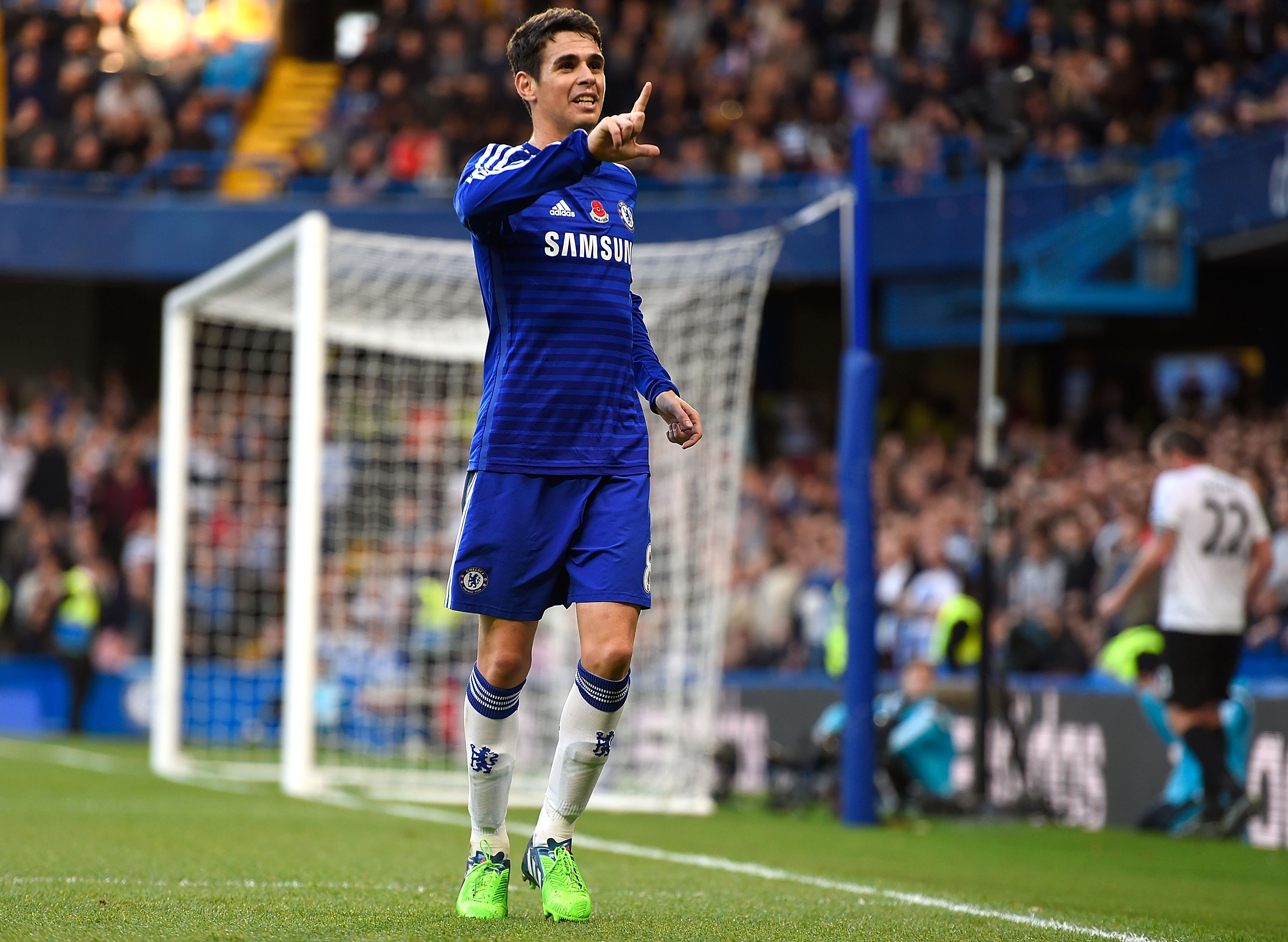 LONDON, ENGLAND - NOVEMBER 01: Oscar of Chelsea celebrates scoring the opening goal during the Barclays Premier League match between Chelsea and Queens Park Rangers at Stamford Bridge on November 1, 2014 in London, England. (Photo by Mike Hewitt/Getty Images)