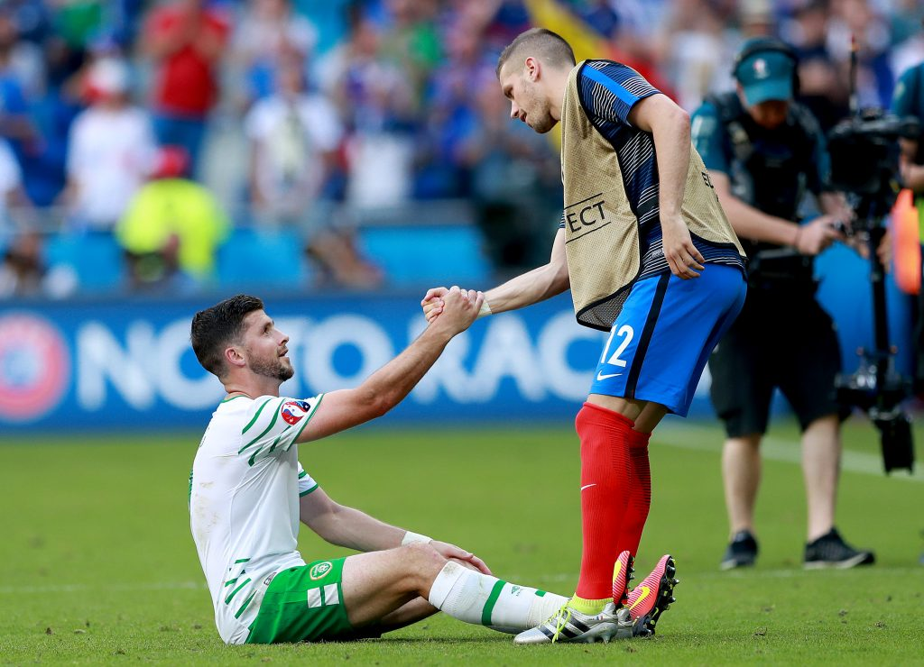 2016 UEFA European Championship Round Of 16, Parc Olympique Lyonnais, Lyon, France 26/6/2016 Republic of Ireland vs France Ireland's Shane Long dejected with Morgan Schneiderlin of France Mandatory Credit ©INPHO/James Crombie